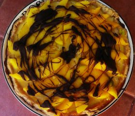 Lemon tart with mango and dark chocolate topping